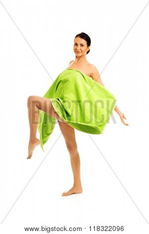 Woman wrapped in towel with leg up