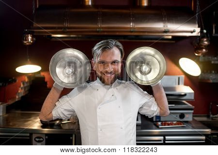 Funny chef cook at the kitchen