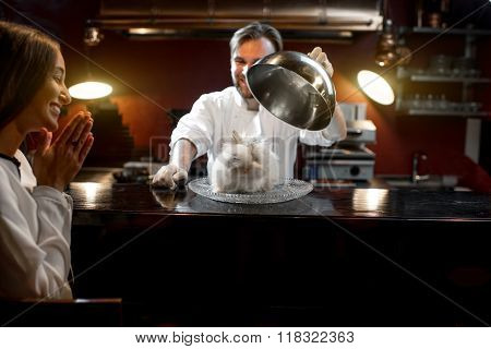 Chef cook serving alive rabbit