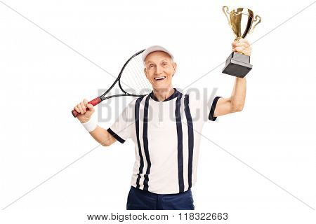 Senior amateur tennis player holding a golden trophy and smiling isolated on white background