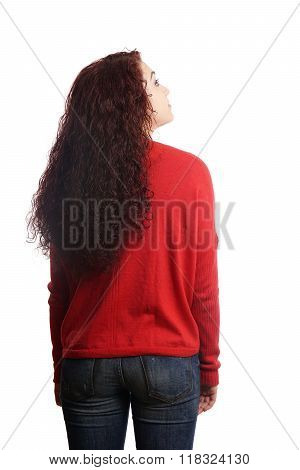 rear view of young woman looking up