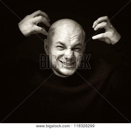 Portrait angry displeased adult man screaming isolated on gray wall background. Negative human emotion.