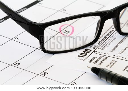 1040 tax form with glasses