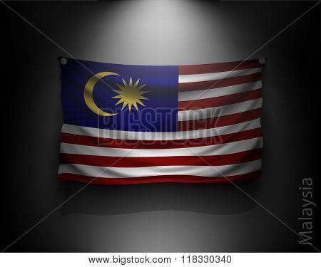 Waving Flag Malaysia On A Dark Wall