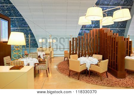 DUBAI, UAE - MARCH 31, 2015: interior of Emirates first class lounge. Emirates is the largest airline in the Middle East. It is an airline based in Dubai, United Arab Emirates.