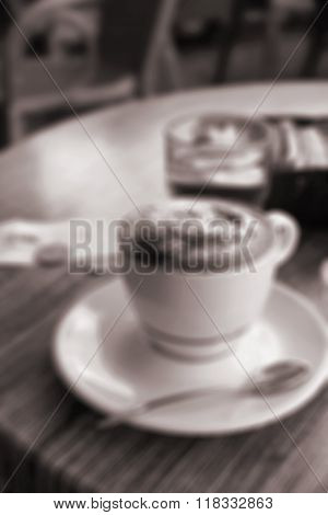 A Cup Of Coffee In Coffee Shop. In Blur Style. In Sepia Toned. Retro Style
