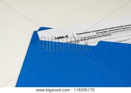 Tax Form 1094-c on Light Background