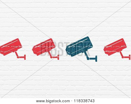 Security concept: cctv camera icon on wall background