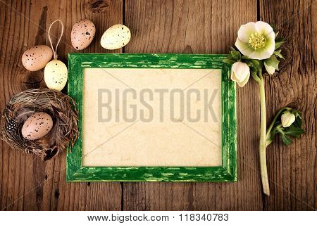 Vintage Easter decoration on old wooden board with copy space