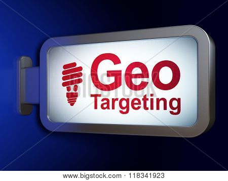 Business concept: Geo Targeting and Energy Saving Lamp on billboard background