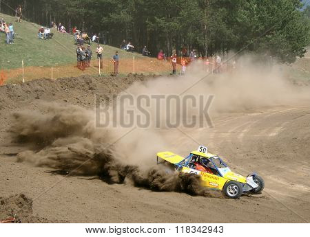 ZLATOUST, RUSSIA - MAY 15: Buggy (No. 50) of team Nizhniy Tagil competes at the annual auto cross racing Championship of Chelyabinsk region on May 15, 2010 in Zlatoust, Chelyabinsk region, Russia.