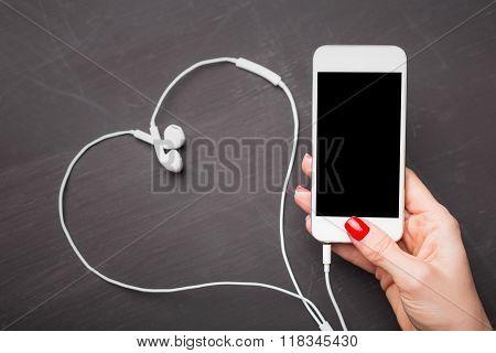 Smartphone with heart shape headphones