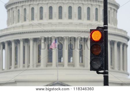 Red traffic light with US Capitol Building background that symbolize negative legislation