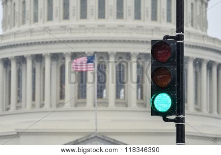 Green traffic light with US Capitol Building background that symbolize positive legislation
