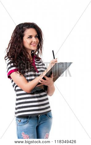 Young business woman or teacher holding a clipboard, isolated on white background