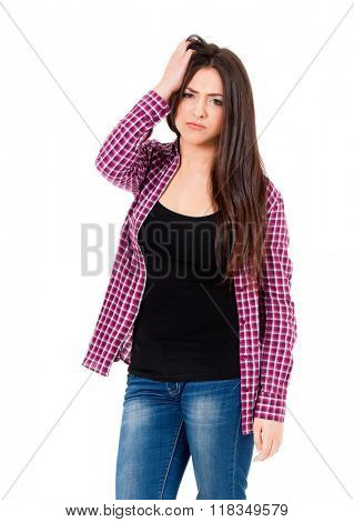 Concept of problems and headache. Girl puts hands on the head, isolated on white.