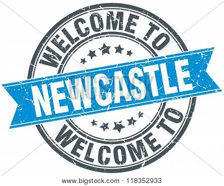 welcome to Newcastle blue round vintage stamp