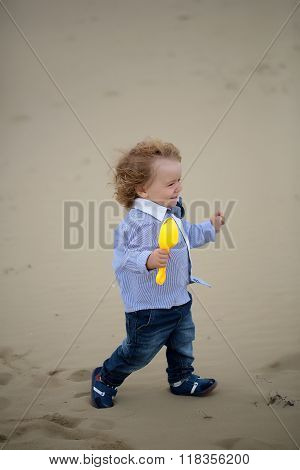 Joyful Baby Boy On Beach