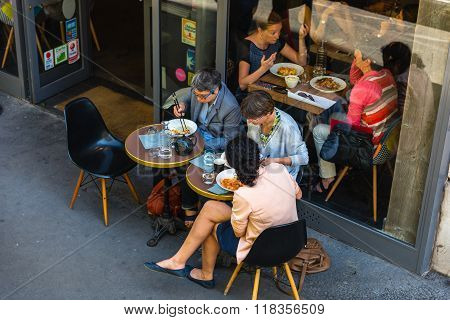 Parisians And Tourists Enjoy Food And Drinks In Cafe