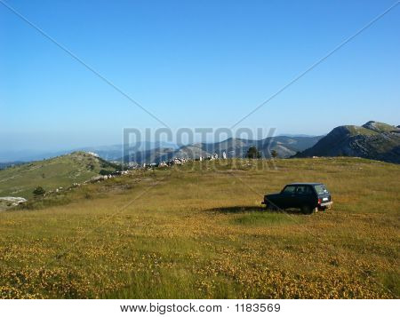 Terrain Vehicle In Mountain Landscape In Croatia