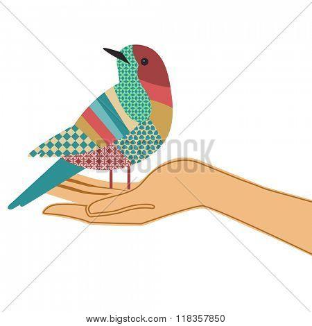 Beautiful bird with pattern sitting on hand