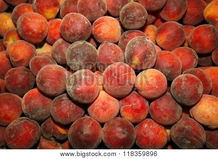 Fresh Peaches On Market Stall As A Background