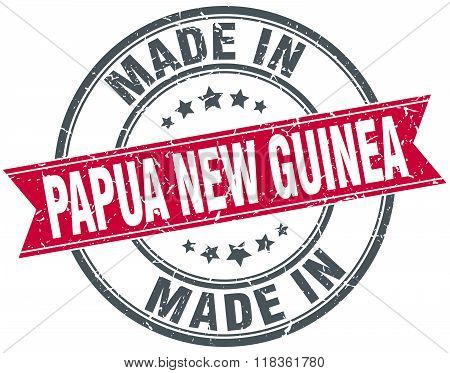 made in Papua New Guinea red round vintage stamp