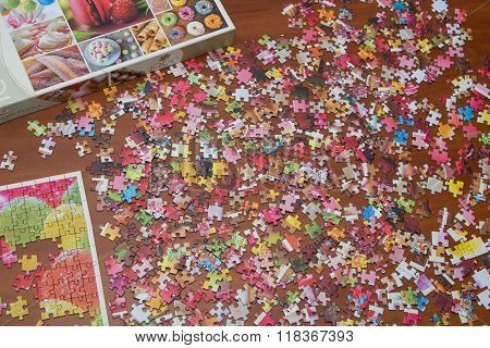 colorful jigsaw puzzle on the desk