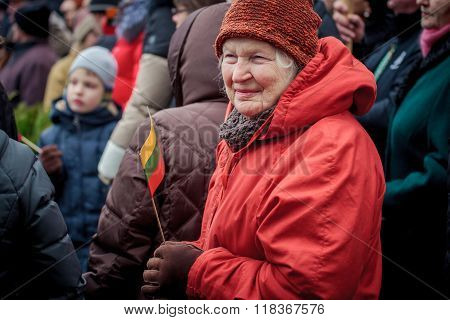 Elderly Woman Holds The Lithuanian Flag