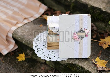 Shabby chic decor and fallen autumn leaves.