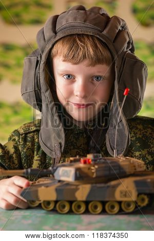 Boy Playing Toy Military Tank