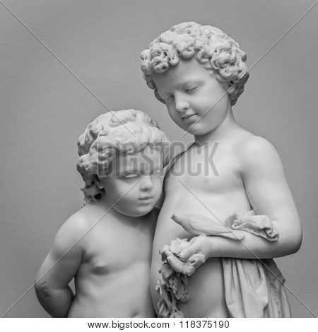 Marble sculpture of girl and boy