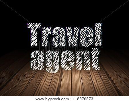 Travel concept: Travel Agent in grunge dark room