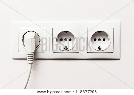 Triple Electrical Socket With Plugged Cable.