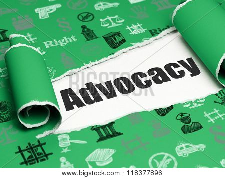 Law concept: black text Advocacy under the piece of  torn paper