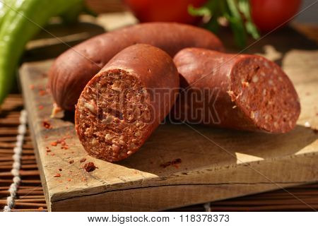 Turkish sausage sucuk on a cutting board
