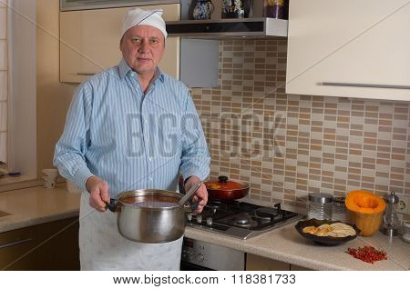 Portrait of amateur male cook in a kitchen
