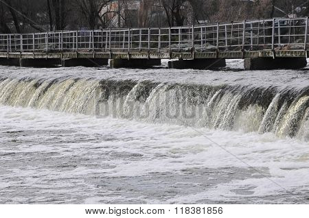 Waterfall on the river. Groyne hydraulic structure of on the river Ros. City of Bila Tserkva.