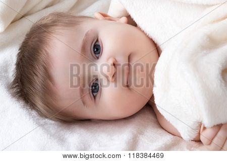 Portrait infant lying on the bed