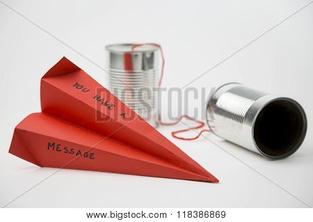 Paper Plane And Cans For A Simple Communication