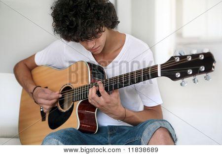 Teenager playing guitar