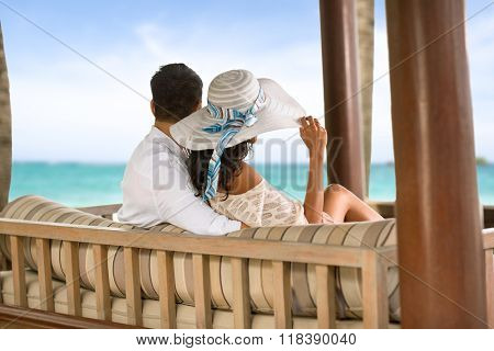 Back view of couple relaxing on holiday in Bali, vacations holidays suntan concept