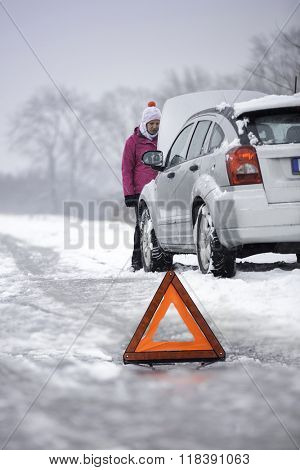 Car defect - car breakdown in a rural area in winter season