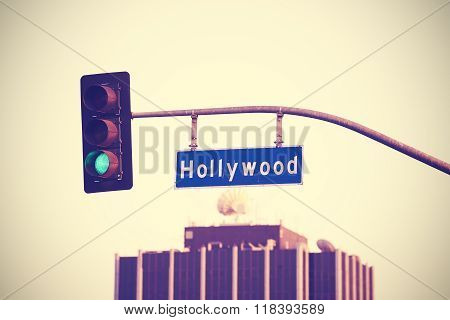 Vintage Toned Hollywood Street Sign And Traffic Lights, La, Usa.