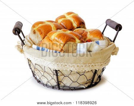 Hot Cross Buns in a vintage wire basket over white