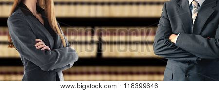 Two businesspeople in front of a bookcase