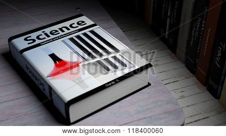Hardcover book on Science with illustration on cover, on wooden surface.
