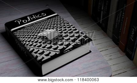 Hardcover book on Politics with illustration on cover, on wooden surface.
