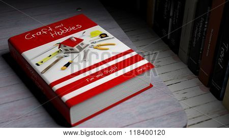 Hardcover book on Craft and Hobbies with illustration on cover, on wooden surface.