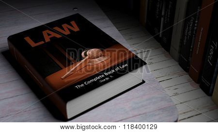Hardcover book on Law with illustration on cover, on wooden surface.